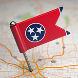 Tennessee Small Flag on a Map Background.