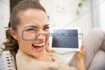 Portrait of happy young woman with tablet pc