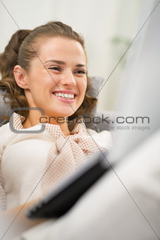 Portrait of happy young woman using laptop