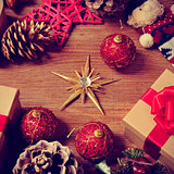 christmas gifts and ornaments on a rustic wooden table