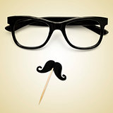 eyeglasses and moustache as a hipster guy, with a retro effect