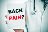 doctor with a signboard with the question back pain?