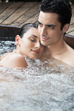 Young couple relaxing in Jacuzzi