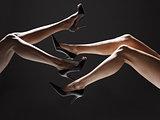 Two women wearing stilettos (low section)