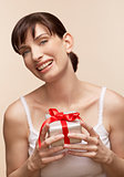 Mid adult woman holding gift