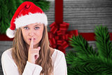 Composite image of festive blonde keeping a secret
