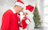 Composite image of festive mature couple holding gift