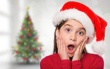 Composite image of festive little girl looking surprised