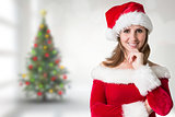 Composite image of pretty girl in santa outfit