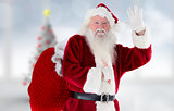 Composite image of santa claus waving