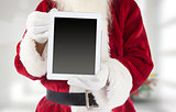 Composite image of santa claus showing tablet pc