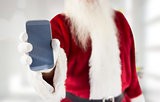 Composite image of santa claus showing smartphone