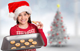 Composite image of festive little girl offering cookies