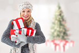 Composite image of happy blonde with gifts