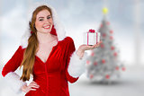 Composite image of pretty girl in santa costume holding gift box