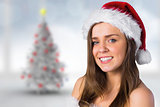 Composite image of sexy santa girl smiling at camera
