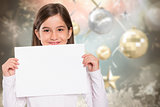 Composite image of cute little girl showing card