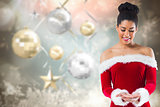 Composite image of pretty santa girl presenting with hands