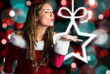 Composite image of sexy santa girl blowing a kiss