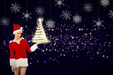 Composite image of pretty santa girl presenting with hand