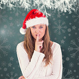 Composite image of festive blonde keeping a secret