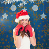 Composite image of festive blonde with boxing gloves