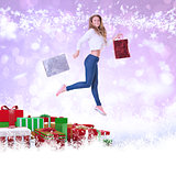 Composite image of pretty blonde with shopping bags