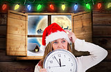 Composite image of festive blonde showing a clock