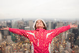 Composite image of cute girl in winter clothes with arms out