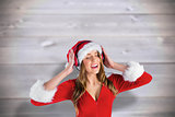 Composite image of sexy santa girl listening to music