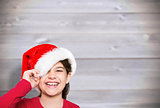 Composite image of festive little girl smiling at camera