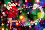 Composite image of woman standing with christmas presents