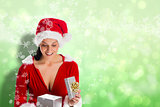Composite image of smiling woman opening christmas present