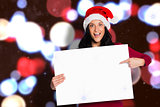 Composite image of woman pointing at white sign