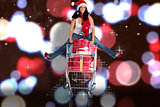 Composite image of woman jumping with shopping trolley