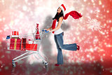 Composite image of woman standing with shopping trolley