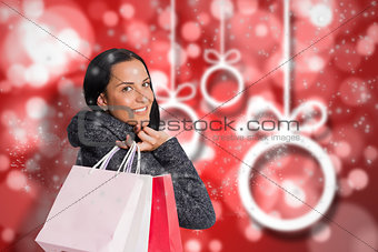 Composite image of smiling woman holding shopping bag