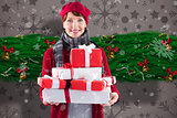 Composite image of smiling woman holding large presents