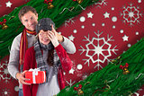 Composite image of man giving woman a present
