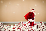Composite image of santa walking on pile of gifts