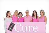 Composite image of smiling women wearing pink for breast cancer awareness