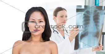 Attractive nude brunette posing looking
