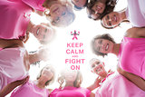Composite image of happy women smiling in circle wearing pink for breast cancer