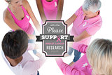 Composite image of group wearing pink and ribbons for breast cancer with hands together
