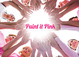 Happy women in circle wearing pink for breast cancer