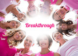 Group of happy women in circle wearing pink for breast cancer