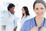 Composite image of confident nurse standing