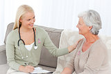 Composite image of doctor talking with her patient