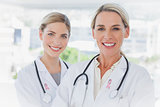 Composite image of blonde doctors standing together