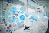 Composite image of scientist in protective suit working with cell diagram interface